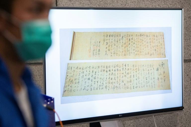 "Someone handling the poetry scroll cut it in half after judging it ""too difficult to display"", police said"