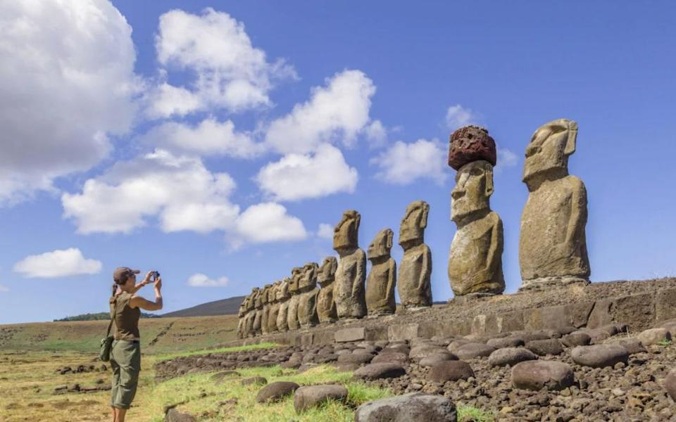 Mo'ai, carved from volcanic tufa, stand like strange sentinels all over Easter Island - David Madison
