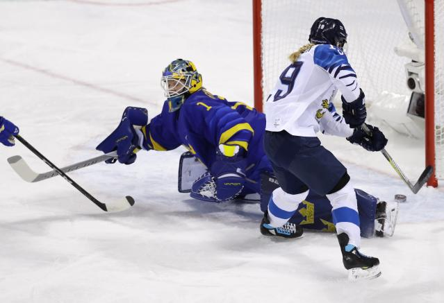 Ice Hockey - Pyeongchang 2018 Winter Olympics - Women's Quarterfinal Match - Finland v Sweden - Kwandong Hockey Centre, Gangneung, South Korea - February 17, 2018 - Petra Nieminen of Finland scores against goalkeeper Sara Grahn of Sweden. REUTERS/David W Cerny