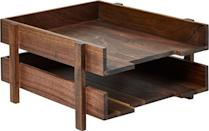 """<p> Even the most devoutly digital of us will inevitably accumulate some paperwork, so keep it in good order with The Conran Shop's elegant solid-walnut 'Stacked Tray'. Stationery addicts, take note – there's also a coordinating pencil case and caddy. £115, <a href=""""https://www.conranshop.co.uk/catalog/product/view/id/35012/s/sliding-tray-walnut/"""" rel=""""nofollow noopener"""" target=""""_blank"""" data-ylk=""""slk:conranshop.com"""" class=""""link rapid-noclick-resp"""">conranshop.com</a></p>"""