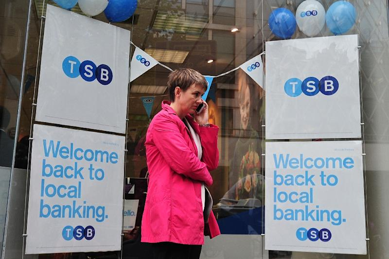 A woman talks on her phone outside a TSB bank branch in central London (AFP Photo/Carl Court)