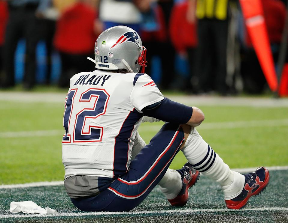 <p>New England Patriots' Tom Brady sits on the field after the NFL Super Bowl 52 football game against the Philadelphia Eagles Sunday, Feb. 4, 2018, in Minneapolis. The Eagles won 41-33. (AP Photo/Charlie Neibergall) </p>