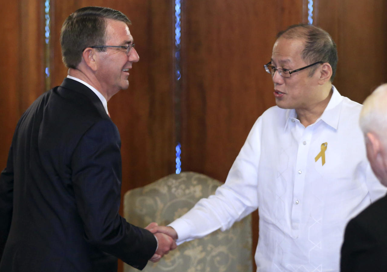 """<p> Philippine President Benigno Aquino III, right, shakes hands with U.S. Defense Secretary Ash Carter during his courtesy call at the Malacanang presidential palace in Manila, Philippines on Thursday, April 14, 2016. Carter is in the country as US and Philippine forces participate in a joint military exercise called shoulder-to-shoulder or """"Balikatan"""". (Romeo Ranoco/Pool Photo via AP) </p>"""