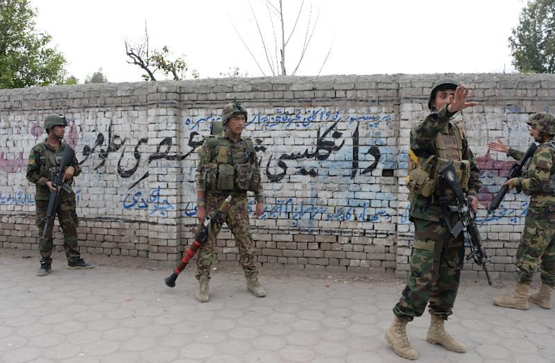 Afghan soldiers arrive at the site of an attack in front of the Indian consulate in Jalalabad, on March 2, 2016 (AFP Photo/Noorullah Shirzada)