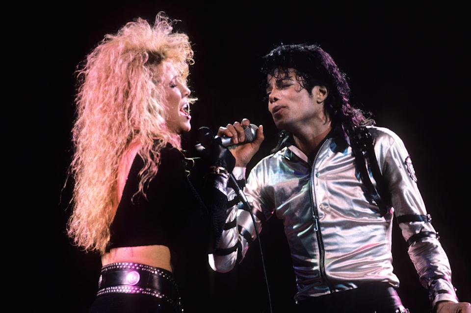 """VARIOUS, VARIOUS - JUNE 25:  Sheryl Crow and Michael Jackson perform during the """"BAD"""" Tour circa 1988.  (Photo by Kevin Mazur/WireImage)"""