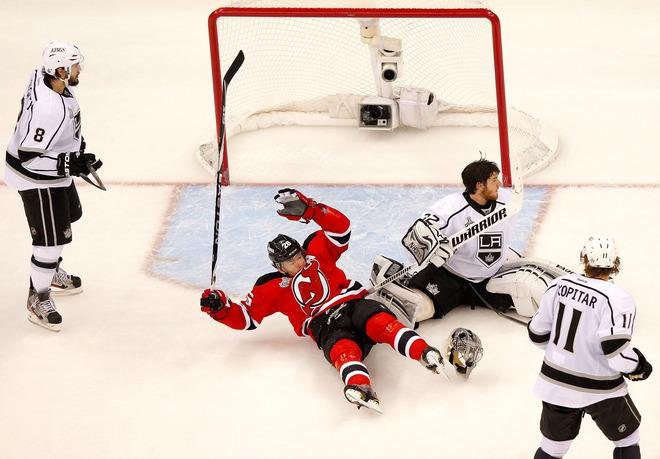 NEWARK, NJ - JUNE 02:  Patrik Elias #26 of the New Jersey Devils collides with Jonathan Quick #32 of the Los Angeles Kings as Drew Doughty #8 and Anze Kopitar #11 look on during Game Two of the 2012 NHL Stanley Cup Final at the Prudential Center on June 2, 2012 in Newark, New Jersey.  (Photo by Paul Bereswill/Getty Images)