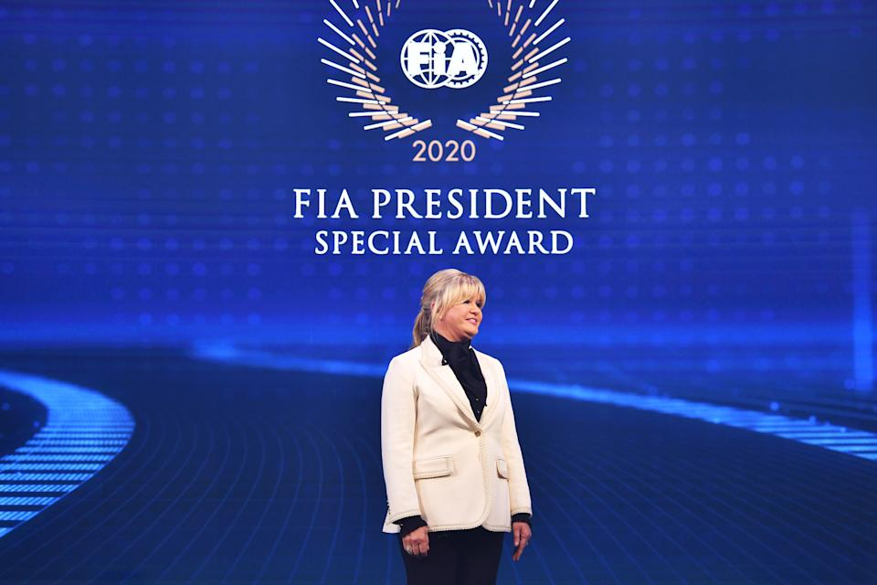 GENEVA, SWITZERLAND - DECEMBER 18: Corinna Schumacher collects the FIA President Special Award on behalf of her husband Michael Schumacher during the 2020 FIA Prize Giving on December 18, 2020 in Geneva, Switzerland. (Photo by Harold Cunningham/FIA via Getty Images)