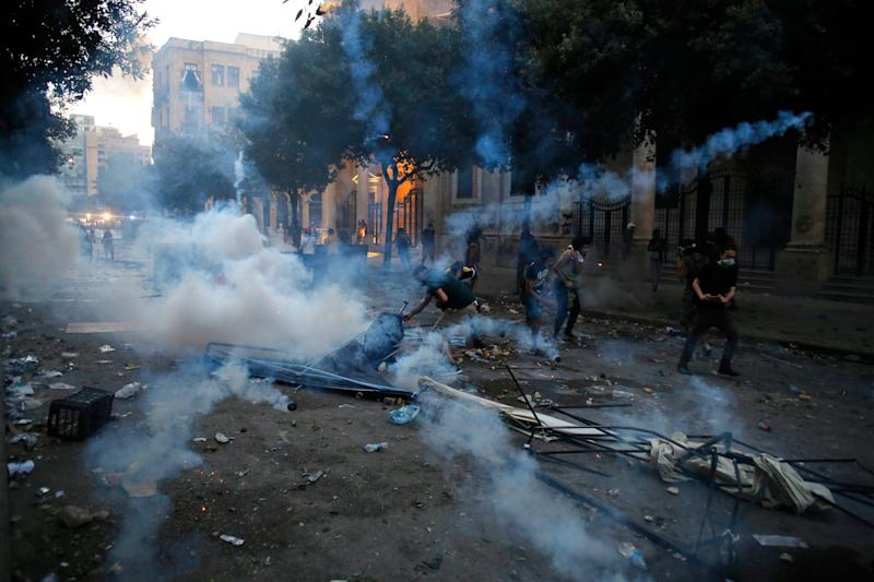 Protestors clash with police during a protest against the political elites and the government after this week's deadly explosion at Beirut port which devastated large parts of the capital in Beirut, Lebanon, Aug. 8, 2020