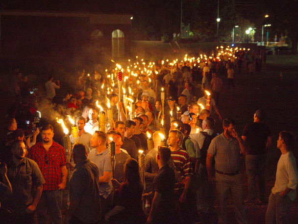 White nationalists carry torches on the grounds of the University of Virginia, on the eve of a planned Unite The Right rally in Charlottesville, Virginia, U.S. August 11, 2017. <p> Alejandro Alvarez/News2Share via REUTERS</p>