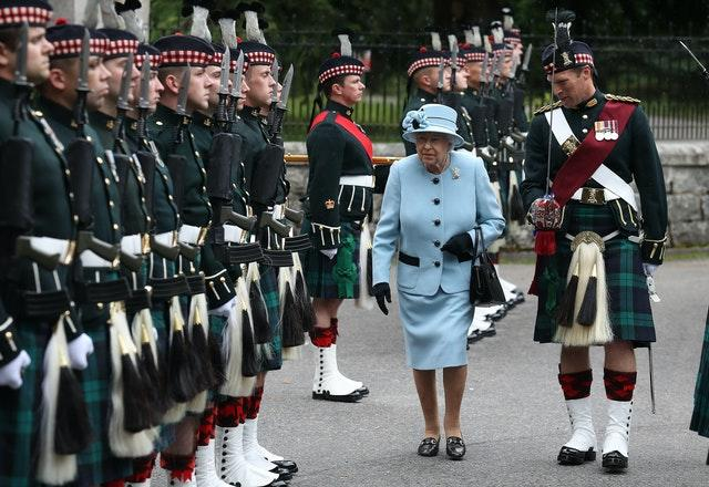 The Queen inspects the Balaklava Company, 5 Battalion The Royal Regiment of Scotland at the gates at Balmoral, as she took up summer residence in 2019