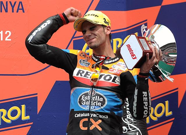 Estrella Galicia's Portuguese Miguel Oliveira celebrates on the podium after the Moto3 race of the Catalunya Moto GP Grand Prix at the Catalunya racetrack in Montmelo, near Barcelona, on June 3, 2012. Blusens Avintia's Spanish Maverick Vinales won the race ahead of Red Bull KTM Ajo's German Sandro Cortese and Estrella Galicia's Portuguese Miguel Oliveira. AFP PHOTO / LLUIS GENELLUIS GENE/AFP/GettyImages