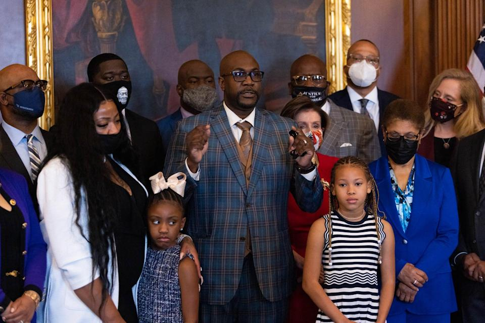 Philonise floyd, brother of George Floyd, speaks to the press  while standing with House Speaker Nancy Pelosi, Dp-CA, other members of the Floyd family prior to a meeting to mark the anniversary of the death of George Floyd, on May 25, 2021, on Capitol Hill, in Washington, DC. (Photo by Graeme Jennings / POOL / AFP) (Photo by GRAEME JENNINGS/POOL/AFP via Getty Images)