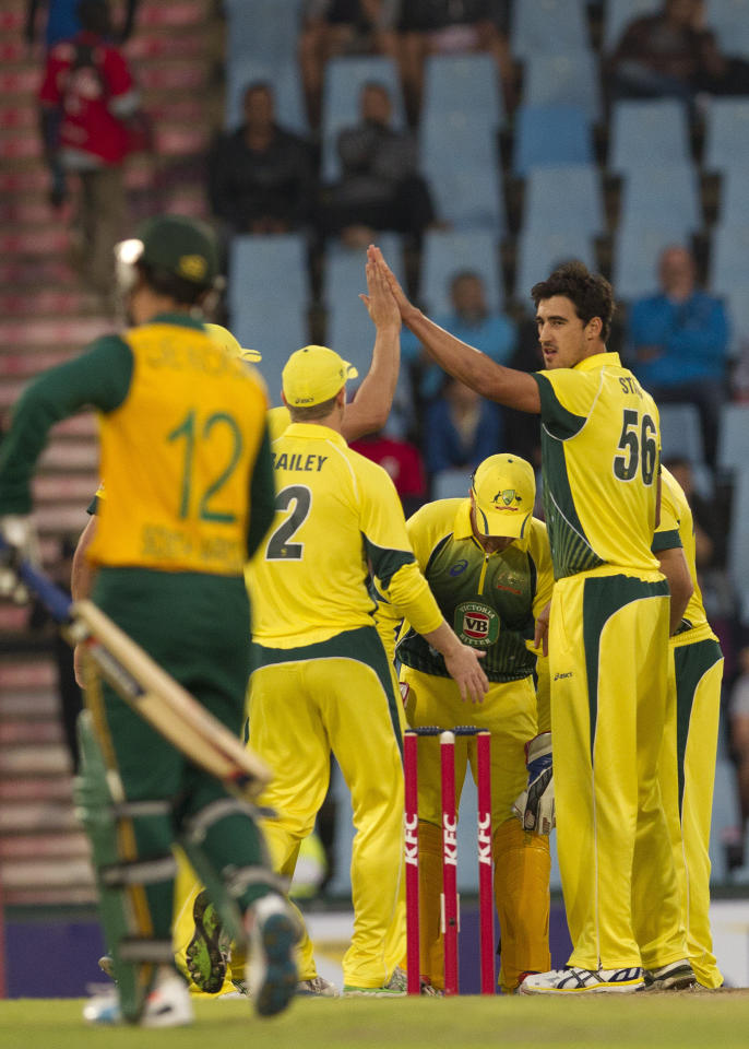 Australia's bowler Mitchell Starc, right, celebrates with teammate after taking a wicket during their T20 Cricket match against South Africa at Centurion Park in Pretoria, South Africa, Friday, March 14, 2014. (AP Photo/Themba Hadebe)