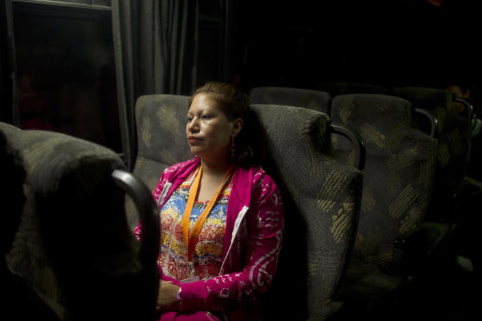 Amelia Reyes-Jimenez rides the bus to work in Zapopan, Mexico, Friday, Aug. 17, 2012. Reyes-Jimenez carried her blind and partly paralyzed baby boy, Cesar, across the Mexican border in 1995 seeking better medical care. She settled in Phoenix illegally and had three more children, all American citizens. In 2008 she was arrested after her disabled teen son was found home alone. Locked up in detention, clueless as to her rights or what was happening to her children, she pleaded guilty to child endangerment charges, and then spent two years trying to fight for her right to stay with her children. She lost and was deported back to Mexico without her children in 2010. (AP Photo/Dario Lopez-Mills)