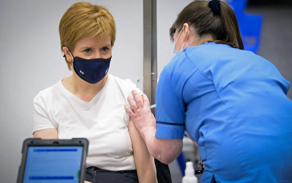 Scotland's First Minister and leader of the Scottish National Party (SNP) Nicola Sturgeon received her first dose of the AstraZeneca/Oxford Covid-19 vaccine on April 15 - JANE BARLOW / AFP