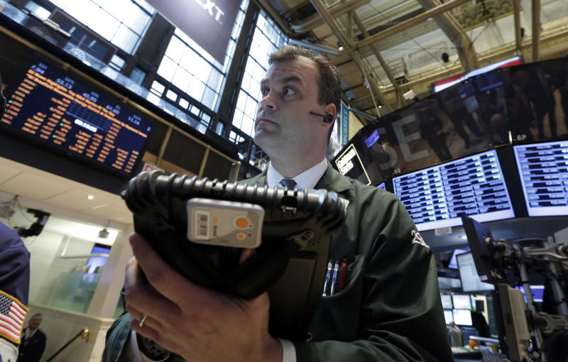 In this Tuesday, Feb. 26, 2013, photo,  Trader William Lawrence works on the floor of the New York Stock Exchange.Futures are rising as Chairman Ben Bernanke heads to Capitol Hill to explain what the Federal Reserve will do to accelerate the economic recovery.  (AP Photo/Richard Drew)