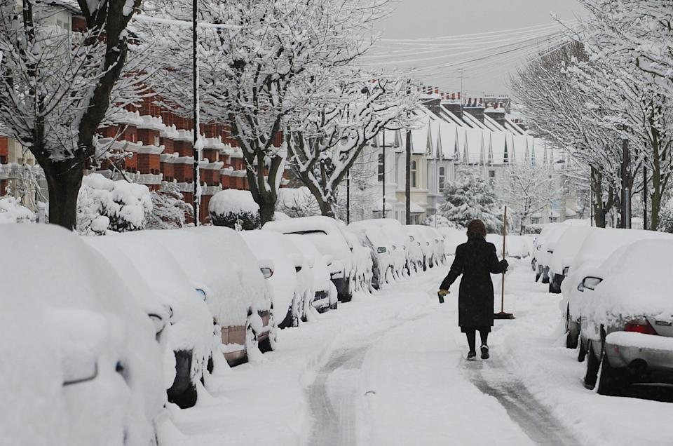 The scene on a street in Chiswick, London, as heavy snowfall hits the UK.