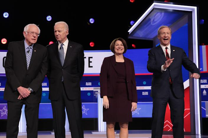 From left: Sanders, Biden, Klobuchar and Tom Steyer arrive onstage for the Democratic presidential primary debate on Feb. 25 in Charleston, S.C. (Scott Olson/Getty Images)