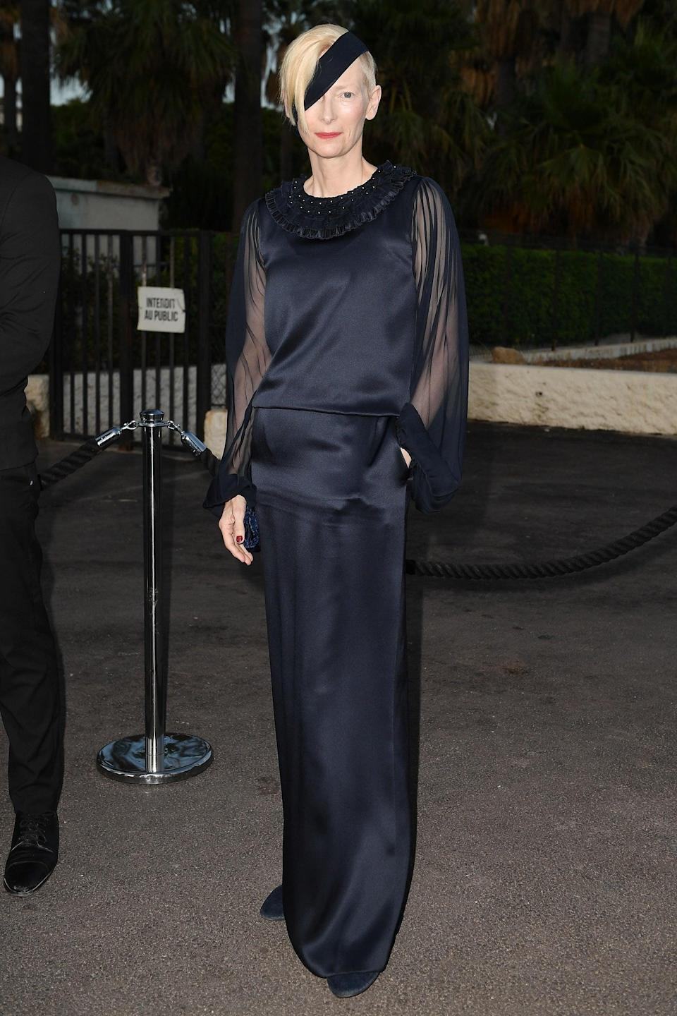 """Ever the icon, actress Tilda Swinton is never afraid to make a statement. This time, she sported a Chanel eye patch and pantsuit. <span class=""""copyright"""">Photo: Jacopo Raule/GC Images.</span>"""