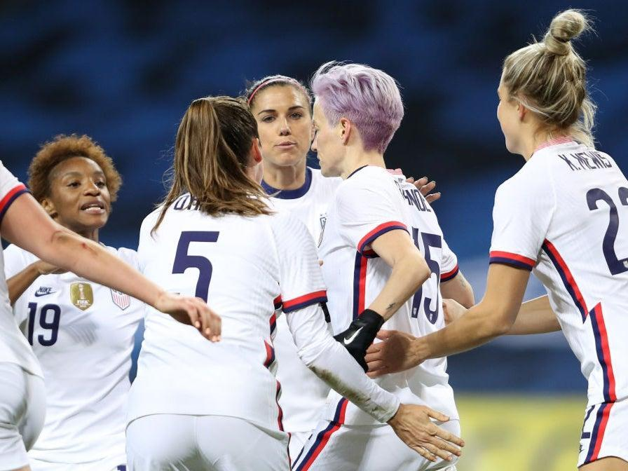 Megan Rapinoe celebrates with teammates after scoring against Sweden (Getty Images)
