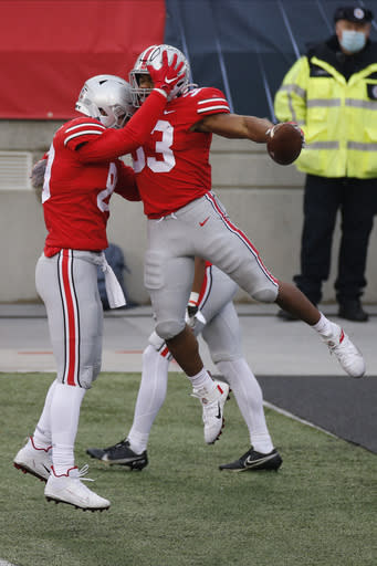 Ohio State running back Master Teague, right, celebrates his touchdown against Indiana with teammate Luke Farrell during the first half of an NCAA college football game Saturday, Nov. 21, 2020, in Columbus, Ohio. (AP Photo/Jay LaPrete)