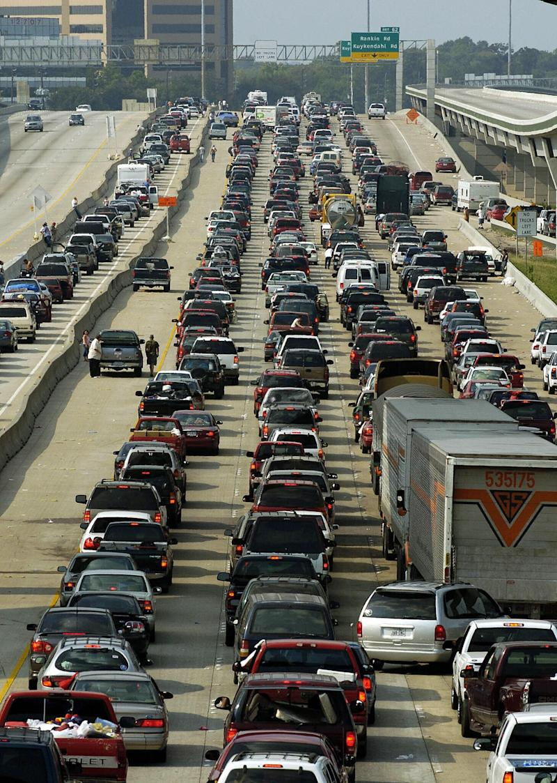 Vehicles jam the northbound lanes of I-45 in Houston as people try to evacuate in advance of Hurricane Rita in 2005. (Photo: STAN HONDA via Getty Images)