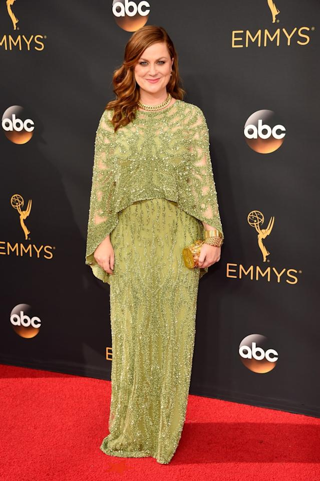 <p>While Amy Poehler and her funny friend Tina Fey both opted for shades of green, Poehler's color just wasn't right. Additionally, the silhouette, which featured a poncholike layer, didn't do her any favors. <em>(Photo: Getty Images)</em> </p>