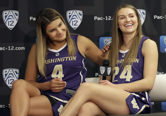Washington's Amber Melgoza, left, and Jenna Moser listen to questions during NCAA college basketball Pac-12 media day in San Francisco, Wednesday, Oct. 10, 2018. (AP Photo/Jeff Chiu)