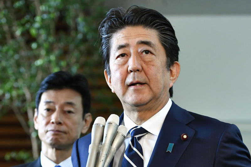 Japanese Prime Minister Shinzo Abe answers reporters' questions at his official residence in Tokyo Friday, Aug. 23, 2019. Abe said South Korea's decision to cancel a deal to share military intelligence is damaging mutual trust, and he vowed to work closely with the U.S. for regional peace. Abe also accused Seoul of not keeping past promises. The military agreement started in 2016. (Yoshitaka Sugawara/Kyodo News via AP)