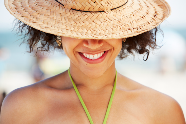 """<p>By now you know the importance of wearing <a href=""""https://www.prevention.com/beauty/skin-care/g35218769/best-sunscreen-for-sensitive-skin/"""" rel=""""nofollow noopener"""" target=""""_blank"""" data-ylk=""""slk:sunscreen"""" class=""""link rapid-noclick-resp"""">sunscreen</a> when you step outside. But have you considered wearing a hat, too? In addition to being super stylish, sun hats help offer an extra layer of protection against the sun's skin-damaging UV rays.</p><p>It's a good idea to wear a hat <em>and</em> sunscreen in the sun, says board-certified dermatologist Heidi Waldorf, M.D., founder of <a href=""""https://waldorfderm.com/"""" rel=""""nofollow noopener"""" target=""""_blank"""" data-ylk=""""slk:Waldorf Dermatology Aesthetics"""" class=""""link rapid-noclick-resp"""">Waldorf Dermatology Aesthetics</a> in New York. The reason: """"Hats block your skin from ultraviolet rays and provide sun protection that doesn't wear off."""" (Remember: Sunscreen needs to be reapplied every two hours because its protection wanes throughout the day—and most people don't apply enough for max protection to begin with.)</p><p>According to the <a href=""""https://www.aad.org/public/everyday-care/sun-protection/what-to-wear-protect-skin-from-sun"""" rel=""""nofollow noopener"""" target=""""_blank"""" data-ylk=""""slk:American Academy of Dermatology (AAD)"""" class=""""link rapid-noclick-resp"""">American Academy of Dermatology (AAD)</a>, wearing sun protective clothing, like a sun hat, can help ward off <a href=""""https://www.prevention.com/health/health-conditions/g20688920/types-of-skin-cancer/"""" rel=""""nofollow noopener"""" target=""""_blank"""" data-ylk=""""slk:skin cancer"""" class=""""link rapid-noclick-resp"""">skin cancer</a>. Basal cell and squamous cell carcinomas, which account for <a href=""""https://www.skincancer.org/skin-cancer-prevention/sun-protection/sun-protective-clothing/"""" rel=""""nofollow noopener"""" target=""""_blank"""" data-ylk=""""slk:90% of all skin cancers"""" class=""""link rapid-noclick-resp"""">90% of all skin cancers</a>, often appear on the head and neck—and hats specifically keep"""