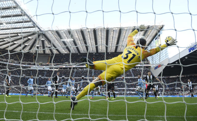 Ederson dives in vain as Shelvey's strike flies beyond his reach. (Photo by Stu Forster/Getty Images)