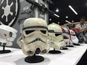 <p>The center helmet, crafted to exacting specifications by the 501st Legion of super-fans, is based on the original 'Star Wars' troopers. To the right are two different versions of Clone Trooper helmets from the prequel trilogy. (Photo from 2015 'Star Wars' Celebration in April.)</p>
