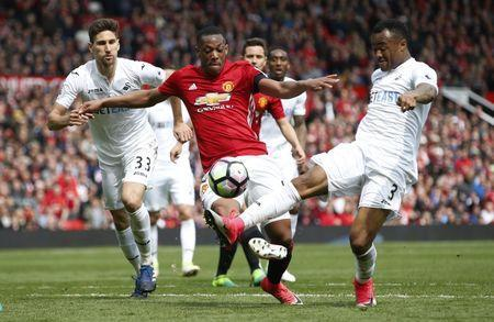 Britain Football Soccer - Manchester United v Swansea City - Premier League - Old Trafford - 30/4/17 Manchester United's Anthony Martial shoots at goal Reuters / Andrew Yates Livepic