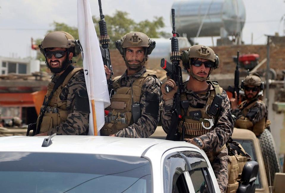 Taliban special force fighters arrive inside the Hamid Karzai International Airport after the US military's withdrawal (AP)