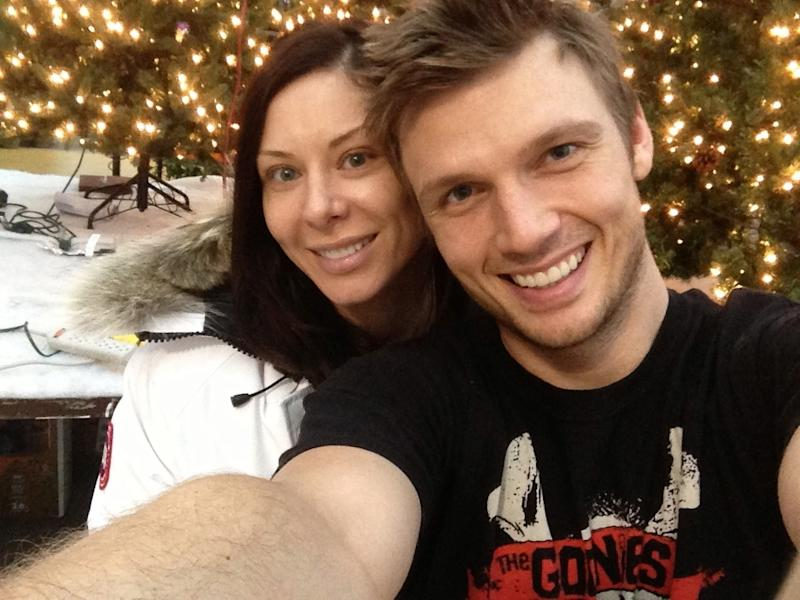 "This undated image released by Nick Carter shows the Backstreet Boys member with his fitness trainer fiance Lauren Kitt. The Backstreet Boys singer proposed to Kitt in February, and he says they may bring their marriage to the small screen. ""There have been offers and opportunities to film the actually wedding, like a TV show,"" the 33-year-old said in a recent interview. The couple appears together in a series of fitness webisodes called ""Kit Fitt."" (AP Photo/Nick Carter)"