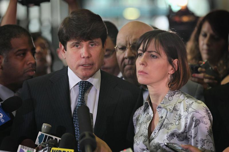 Former Illinois Governor Rod Blagojevich and wife Patti speak to the press following a verdict at his 2010 corruption trial in Chicago: Getty Images