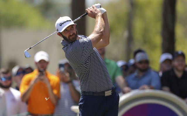 Dustin Johnson tees off on the second hole during the final round of the Valspar Championship golf tournament Sunday, March 24, 2019, in Palm Harbor, Fla. (AP Photo/Mike Carlson)