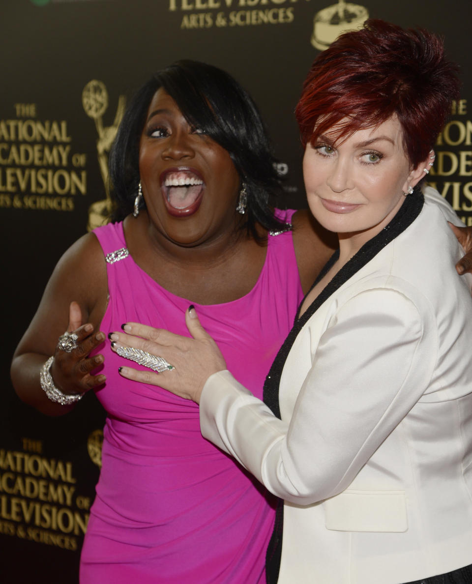 Actress Sheryl Underwood (L) and entertainment personality Sharon Osbourne arrive at the 41st Annual Daytime Emmy Awards in Beverly Hills, California June 22, 2014.   REUTERS/Phil McCarten (UNITED STATES  - Tags: ENTERTAINMENT)  (DAYTIMEEMMYAWARDS-ARRIVALS)