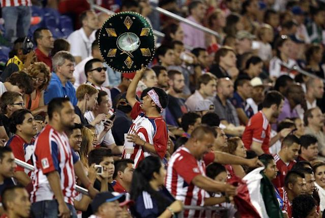 A spectator holds up a large hat during the second half of an international friendly soccer match at Red Bull Arena, Thursday, July 31, 2014, in Harrison, N.J. Bayern Munich won 1-0. (AP Photo/Julio Cortez)