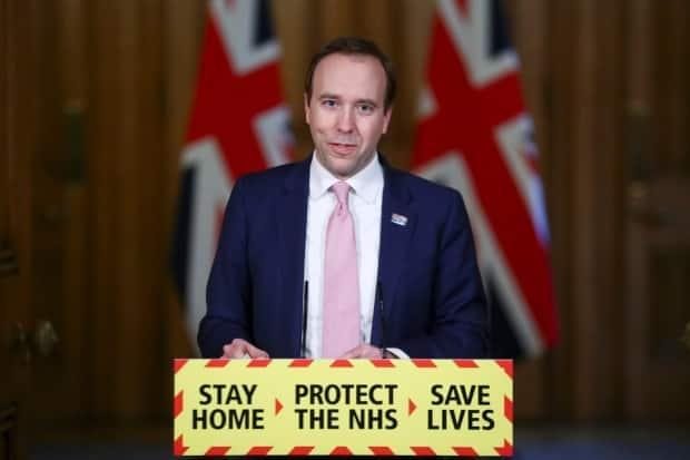 British Health Secretary Matt Hancock speaks to the media in London in March. Beginning last month, the U.K. government has encouraged Britons to pick up free home tests for COVID-19 online or at pharmacies and report results online or through an app.