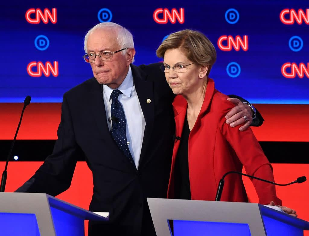 Vermont Sen. Bernie Sanders and Massachusetts Sen. Elizabeth Warren hug after participating in the first round of the second Democratic primary debate, on July 30, 2019. | BRENDAN SMIALOWSKI—AFP/Getty Images
