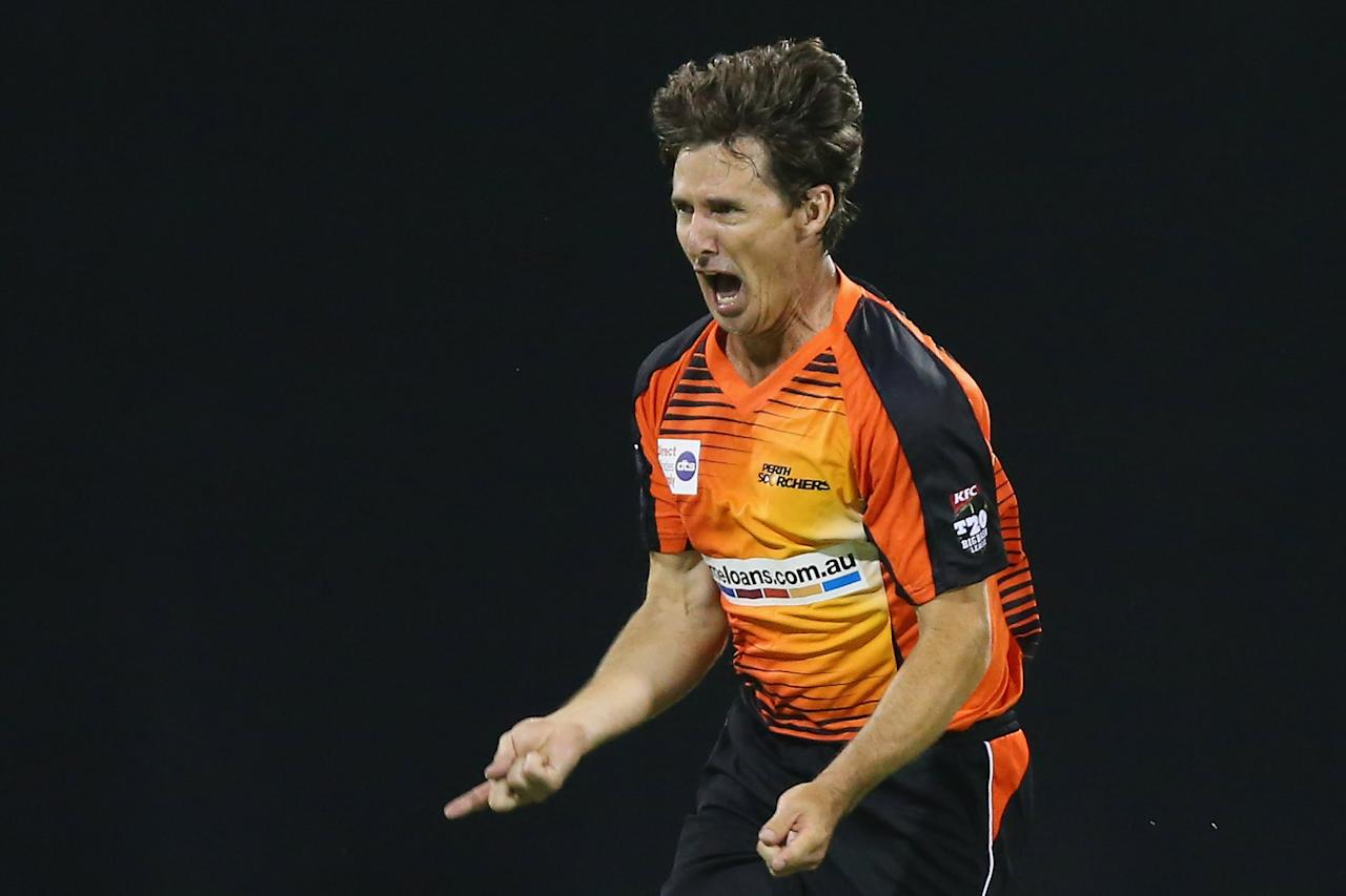 BRISBANE, AUSTRALIA - DECEMBER 22:  Brad Hogg of the Scorchers celebrates after dismissing Dan Christian of the Heat during the Big Bash League match between the Brisbane Heat and the Perth Scorchers at The Gabba on December 22, 2013 in Brisbane, Australia.  (Photo by Chris Hyde/Getty Images)