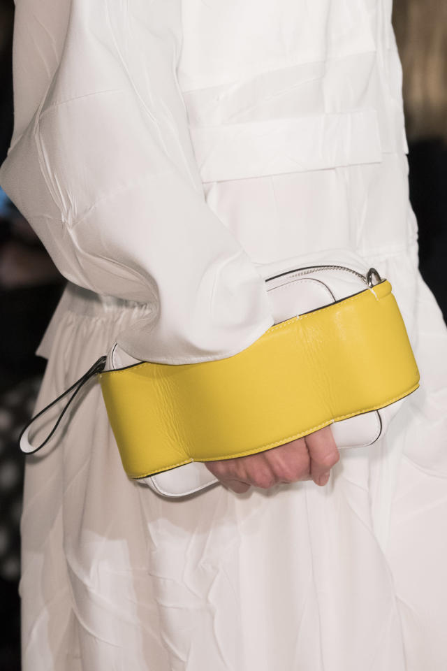 <p><i>White and yellow clutch handbag from the SS18 Joseph collection. (Photo: ImaxTree) </i></p>