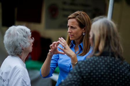 FILE PHOTO: US Democratic congressional candidate Mikie Sherrill (C) speaks with people as she campaigns during the New Jersey State Fair in Augusta, New Jersey, U.S., August 12, 2018.  Picture taken on August 12, 2018.  REUTERS/Eduardo Munoz/File Photo