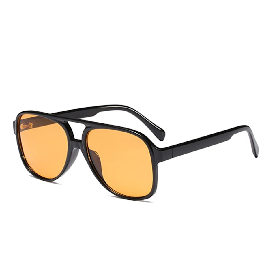 """Black and orange colorways for sunglasses are <a href=""""https://www.glamour.com/gallery/best-womens-sunglasses?mbid=synd_yahoo_rss"""" rel=""""nofollow noopener"""" target=""""_blank"""" data-ylk=""""slk:taking center stage this year"""" class=""""link rapid-noclick-resp"""">taking center stage this year</a>, and TikTokers made this <a href=""""https://vm.tiktok.com/ZMRm2mAjT/"""" rel=""""nofollow noopener"""" target=""""_blank"""" data-ylk=""""slk:affordable pair of aviators"""" class=""""link rapid-noclick-resp"""">affordable pair of aviators</a> go viral quickly. Bonus: The oversized vintage sunnies will set you back only $13 while wearing one of fall's biggest trends. $13, Amazon. <a href=""""https://www.amazon.com/YDAOWKN-Classic-Vintage-Aviator-Sunglasses/dp/B08YR34YV6"""" rel=""""nofollow noopener"""" target=""""_blank"""" data-ylk=""""slk:Get it now!"""" class=""""link rapid-noclick-resp"""">Get it now!</a>"""