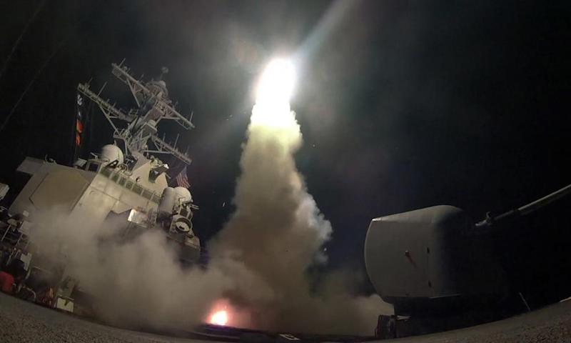 In this image provided by the US navy, the guided-missile destroyer USS Porter (DDG 78) launches a tomahawk land attack missile in the Mediterranean Sea on Friday 7 April 2017.