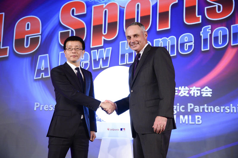 IMAGE DISTRIBUTED FOR LETV - Le Sports Chief Executive Officer Zhenjian Lei, left, and Baseball Commissioner Robert D. Manfred Jr. seen at a press conference for Le Sports and MLB announcing their strategic partnership in China at Caesars Palace on Wednesday, January 6, 2016, in Las Vegas. (Photo by Dan Steinberg /Invision for Letv/AP Images)