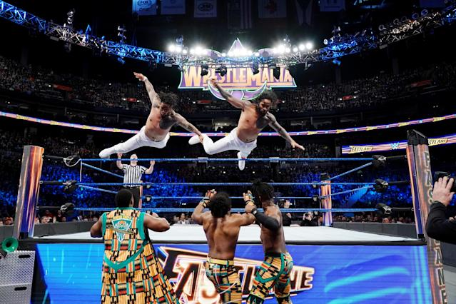 Jimmy and Jey Uso leap over the top rope to take out the New Day at WWE's Fastlane event. (Photo courtesy of WWE)