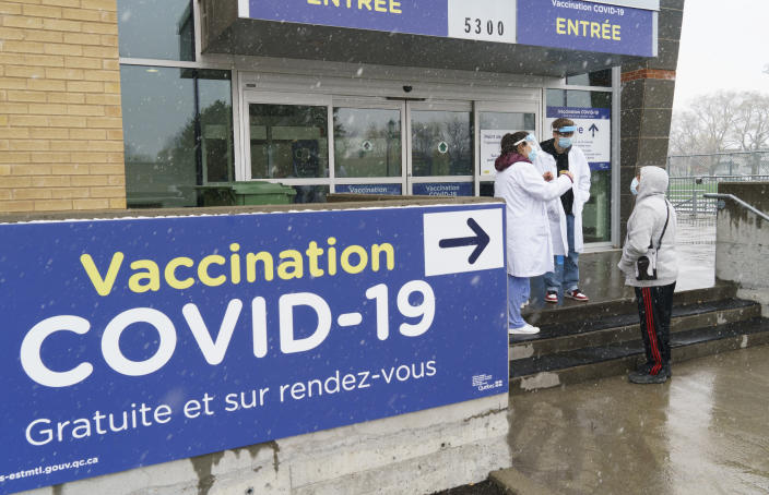 A man is screened before entering a COVID-19 vaccination clinic in Montreal, Wednesday, April 21, 2021. (Paul Chiasson/The Canadian Press via AP)