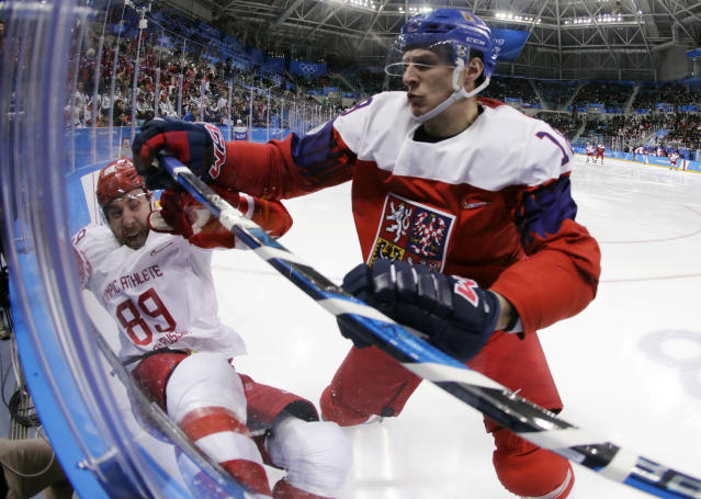 FILE - In this Feb. 23, 2018, file photo, Czech Republic' Dominik Kubalik (18) checks Russia's Nikita Nesterov (89) during the second period of the semifinal round of the men's hockey game at the 2018 Winter Olympics in Gangneung, South Korea. Kubalik is one of the biggest variables for the Chicago Blackhawks as they try to get back to the playoffs after a two-year absence. He could play on one of Chicago's top lines, but he isn't looking too far ahead early in training camp. (AP Photo/Julio Cortez, File)